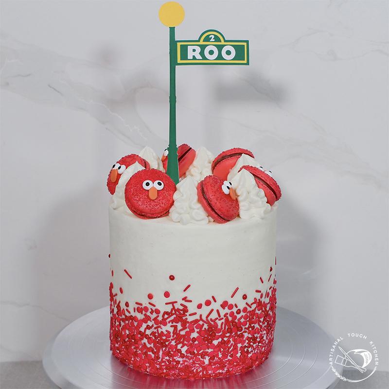 Perfect yellow cake decorated with macarons sprinkles Sesame Street theme Elmo birthday cake