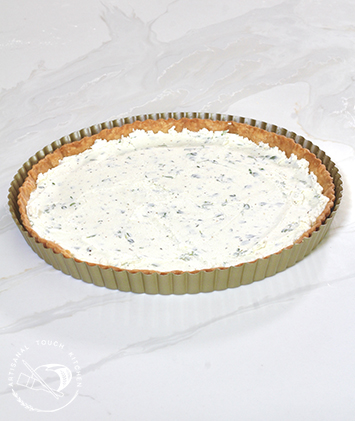 Pâte brisée tart crust filled herbed goat cheese for tomato tart