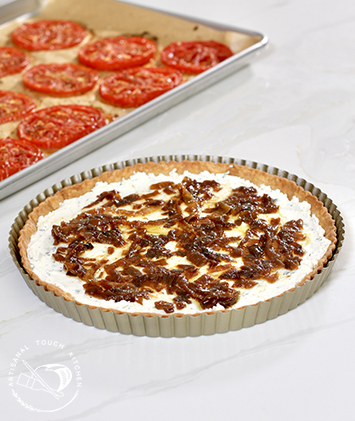 Pâte brisée tart crust herbed goat cheese and caramelized onions roasted tomatoes