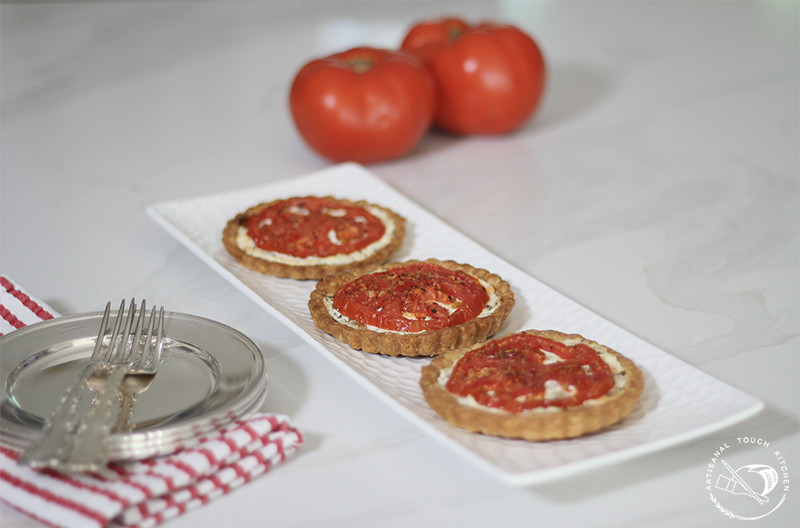 Individual mini tomato tart roasted tomatoes goat cheese caramelized onions