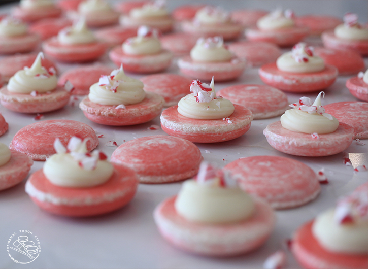 White chocolate peppermint macarons piped filling ganache candy canes